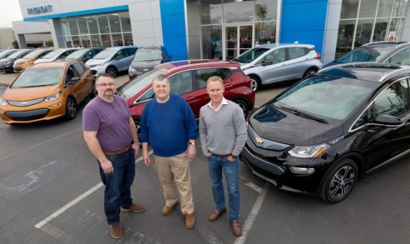 """Customers Bobby Edmonds (l to r) of Castro Valley, CA, William """"Bill"""" Mattos of Fremont, CA, and Steve Henry of Portola Valley, CA take delivery of the first three 2017 Chevrolet Bolt EVs Tuesday, December 13, 2016 at Fremont Chevrolet in Fremont, CA. The all-electric Bolt EV offers an EPA-estimated 238 miles of range on a full charge. (Photo by Martin Klimek for Chevrolet)"""