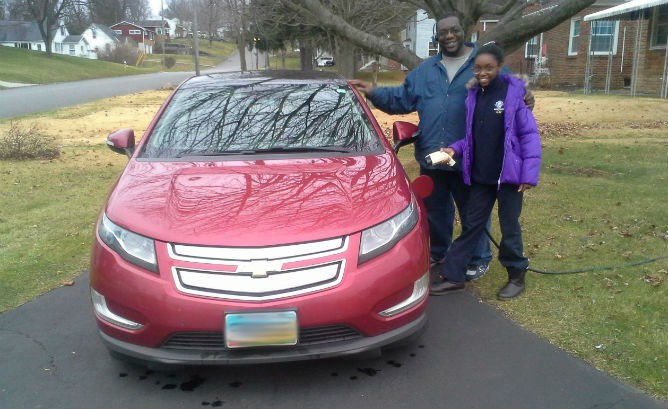 Erick and daughter Erin Belmer with his super-high mileage 2012 Volt.