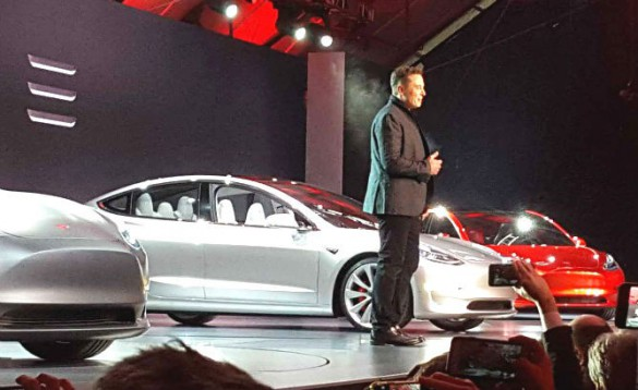 """Musk at the Model 3 intro: """"I want to start, just preface this by talking about why? Why are we doing this?"""" posed Musk. """"Why does Tesla exist? Why are we making electric cars? Why does it matter? It's because its very important to accelerate the transition to sustainable transport. This is really important for the future of the world."""""""